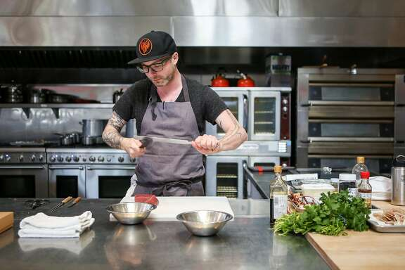 Anthony Strong sharpens a knife as he prepares some of his newest dishes for his new cooking venture Young Fava on Sunday, May 6, 2017 in San Francisco, Calif.