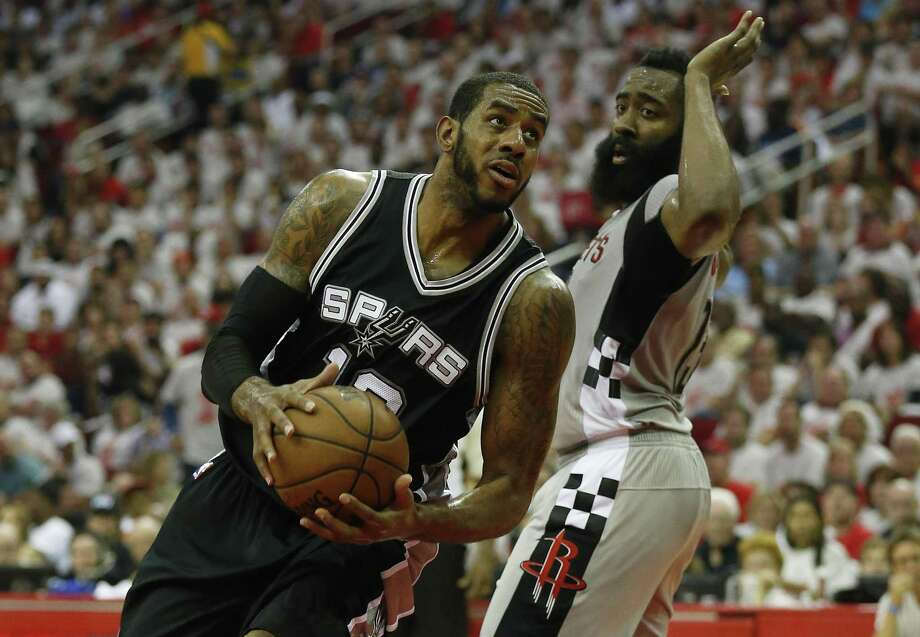 Spurs' LaMarcus Aldridge looks for a shot in the paint against the Rockets' James Harden in Game 4 at the Toyota Center on May 7, 2017. Photo: Kin Man Hui /San Antonio Express-News / ©2017 San Antonio Express-News