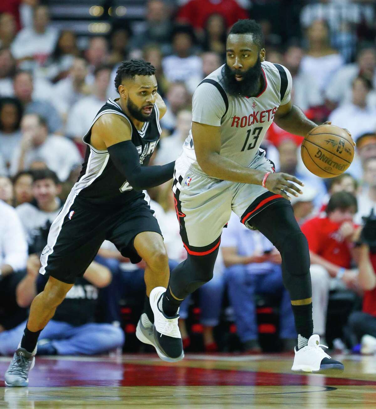 Houston Rockets guard James Harden (13) is pursued by San Antonio Spurs guard Patty Mills (8) during the first half of Game 3 of the second round of the Western Conference NBA playoffs at the Toyota Center, Sunday, May 7, 2017, in Houston. ( Karen Warren / Houston Chronicle )