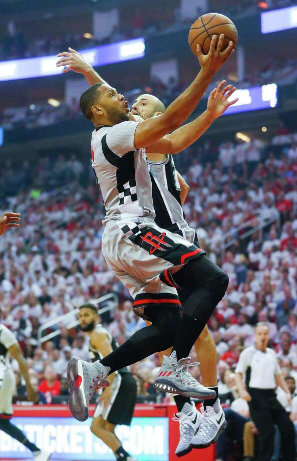 Houston Rockets guard Eric Gordon (10) shoots past San Antonio Spurs guard Manu Ginobili (20) during the first half of Game 3 of the second round of the Western Conference NBA playoffs at the Toyota Center, Sunday, May 7, 2017, in Houston. ( Karen Warren / Houston Chronicle ) Photo: Karen Warren, Staff Photographer / 2017 Houston Chronicle