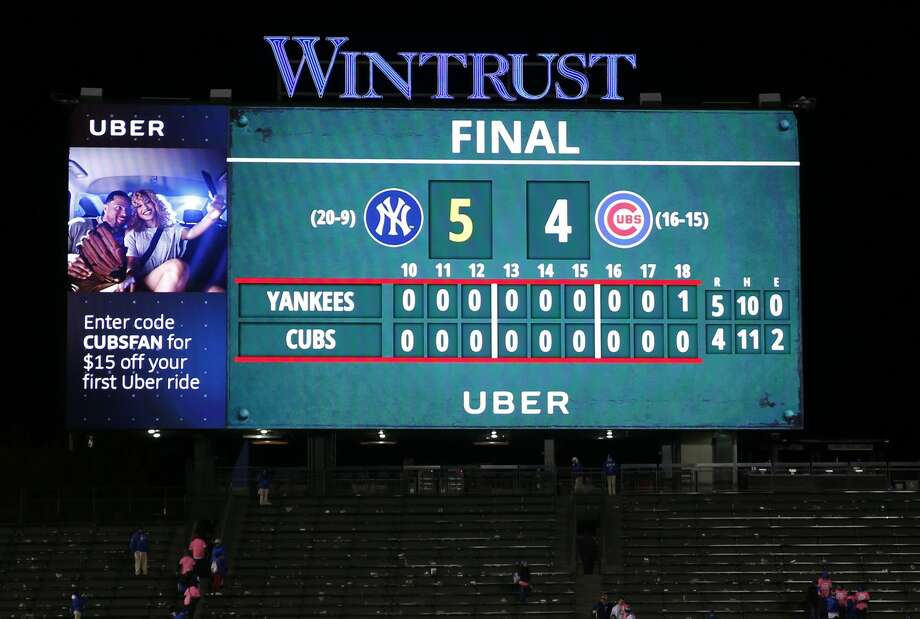 The score board displays the New York Yankees defeated the Chicago Cubs, 5-4, in the 18th inning of an interleague baseball game Monday, May 8, 2017 in Chicago. (AP Photo/Nam Y. Huh) Photo: Nam Y. Huh/Associated Press