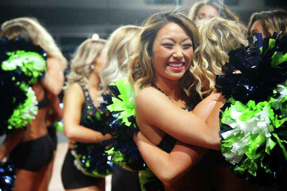Dancers celebrate after finding out they made the 2017 squad during the final round of Sea Gals tryouts, Sunday, May 7, 2017 at CenturyLink Field. Photo: GENNA MARTIN, SEATTLEPI.COM / SEATTLEPI.COM