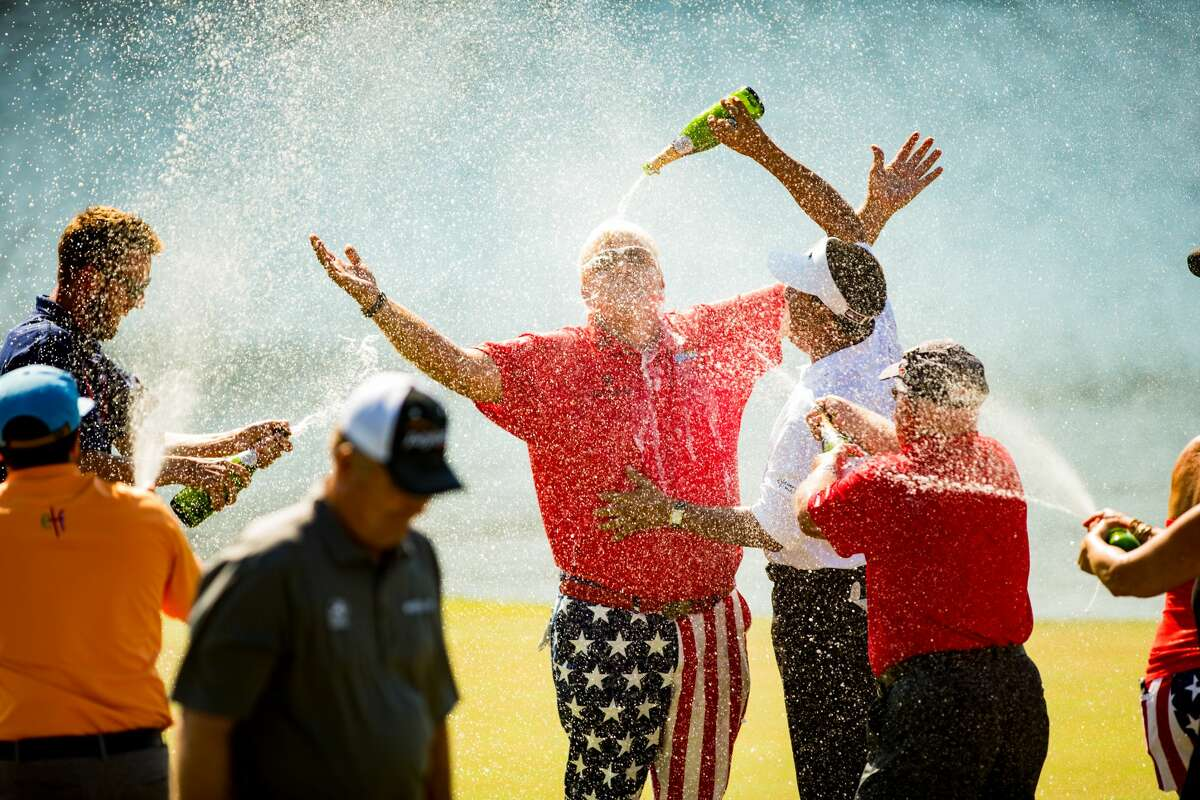 THE WOODLANDS, TX - MAY 07: John Daly of the United States is sprayed with champagne at the eighteenth green following his victory at the PGA TOUR Champions Insperity Invitational at The Woodlands Country Club on May 7, 2017 in The Woodlands, Texas. (Photo by Darren Carroll/Getty Images)