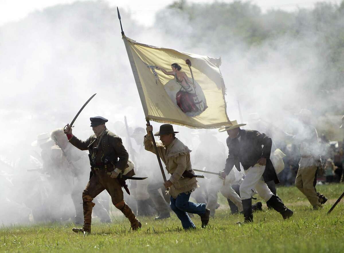 Re-enactors playing the parts of members of the Texian Army, charge toward the Mexican encampment during the Battle of San Jacinto on the grounds of the San Jacinto Battleground in 2011, in Houston, as hundreds of history re-enactors recreate the events leading up to and including the Battle of San Jacinto.