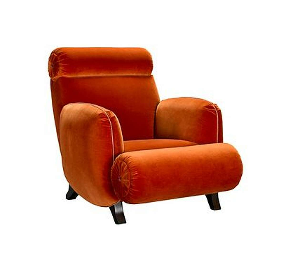 Bold: Jeffrey Bilhuber's Bolton Road chair for Henredon makes a bold statement with this velvety orange upholstery and mid-century touch.