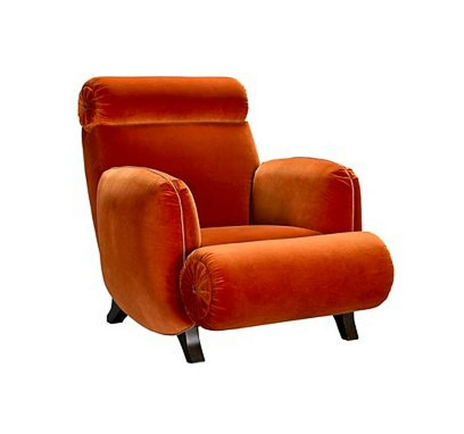 Bold:Jeffrey Bilhuber's Bolton Road chair for Henredon makes a bold statement with this velvety orange upholstery and mid-century touch. Photo: Henredon