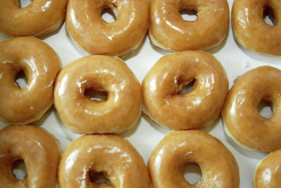 The doughnut is nearly a perfect thing: chewy but with a hint of crisp; sweet but light; designed to be dipped, topped, dusted and sprinkled. To celebrate their 80th birthday, Krispy Kreme is selling a dozen doughnuts for just 80 cents.Continue clicking to see the 10 best doughnut shops in Texas. Photo: Nell Redmond/ Bloomberg News) / Bloomberg