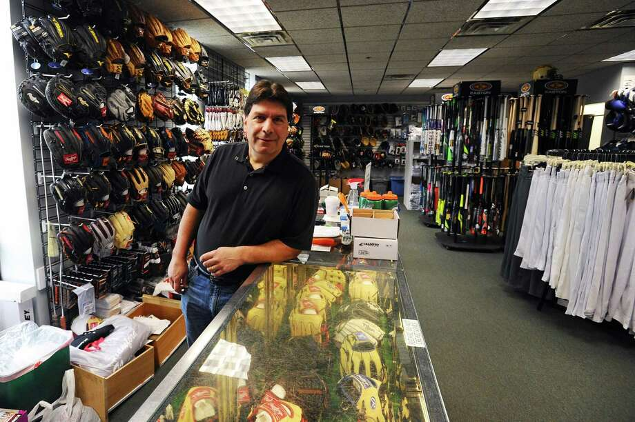 Instant Replay Sports owner Steve Terenzio poses for a photo inside his store's new location on Largo Dr. in Stamford, Conn. on Wednesday, May 3, 2017. Photo: Michael Cummo / Hearst Connecticut Media / Stamford Advocate