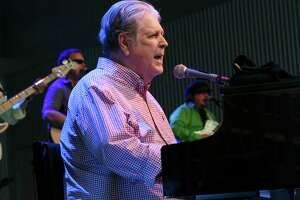 """Brian Wilson performs at Elmwood Park Amphitheater in Roanoke, Va., on Saturday, Aug. 20, 2016. Fifty years after the hit album """"Pet Sounds"""" came out Wilson is touring the world and performing the album along with The Beach Boys co-founder Al Jardine and his 10-piece backing band, which includes the members of a group called the Wondermints. It is the final concert of the FloydFest-presented Totally Rad Roanoke Star City Concert Series. (Heather Rousseau/The Roanoke Times via AP)"""