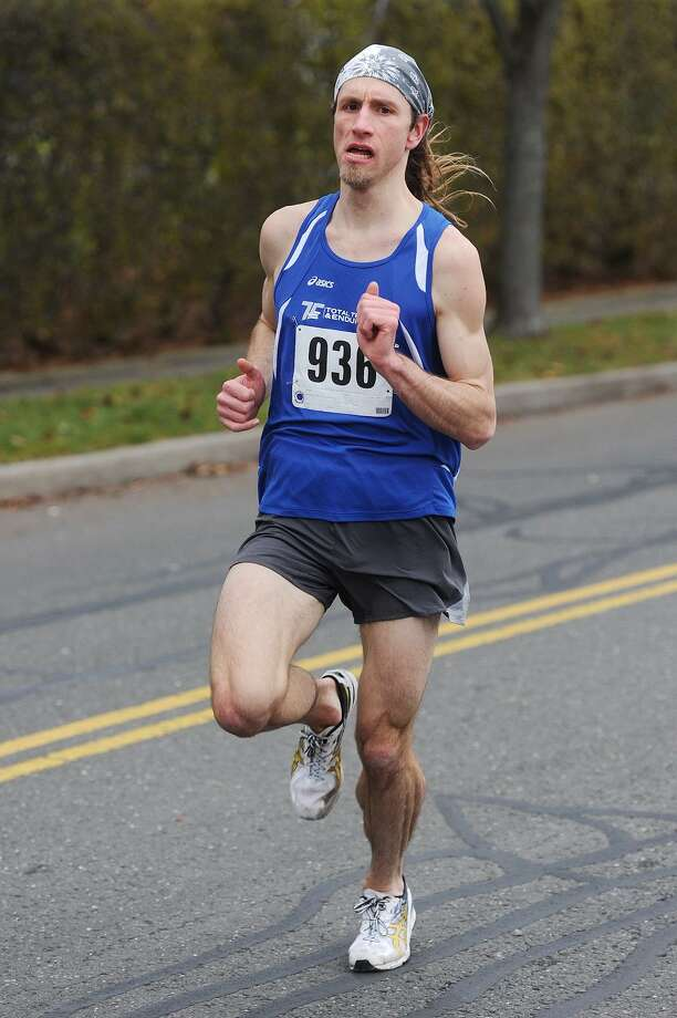 Tim Milenkevich, of Ansonia, races to an easy victory in the 16th Annual William B. Meyer Fairfield Holiday 5k Run for Toys in Fairfield, Conn. on Sunday, December 21, 2014. Photo: Brian A. Pounds / Brian A. Pounds / Connecticut Post