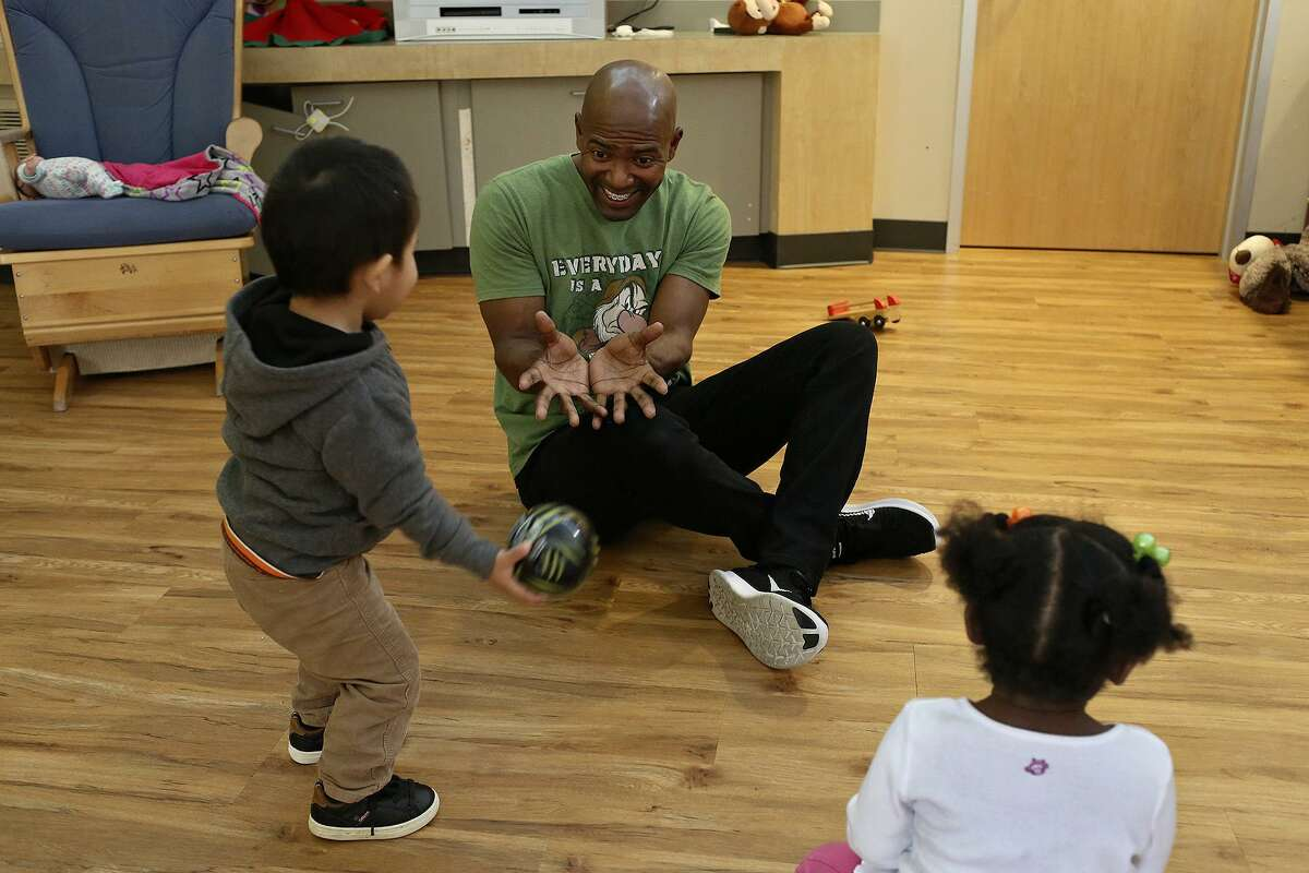 Volunteer Kortney Johnson plays with toddlers at The Children's Shelter in San Antonio on Dec. 31, 2016. Johnson holds a birthday party including gifts and cake for every child who has a birthday while they are staying at the shelter. Johnson is stationed at Ft. Sam Houston while serving in the Army and has volunteered with different organizations every place he has been stationed.