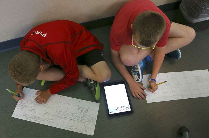 "Students Jackson Cummings,10, (left) and Braden Bergin,10, (right) work on lessons in Heather Smith's in fourth grade reading, writing and social studies class. The subjects are taught in what is called an ""engaged"" manner with electronic devices that lets kids learn at their own pace with a Google Classroom platform. Wheels are on furniture, lighting is controlled, and tables convert to whiteboards. Wobbly stools are used as well as bean bag chairs. Smith's engaged classroom is one of only 17 in the Alamo Heights District."