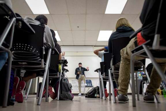 Marlon Lizama speaks to students during an english class at Middle College Tuesday, April 18, 2017, in Houston.  ( Jon Shapley / Houston Chronicle )