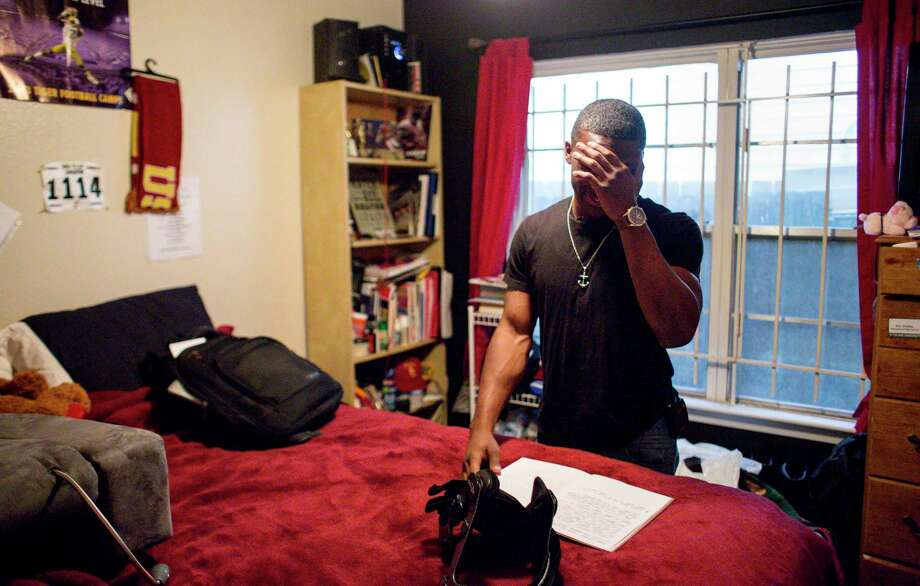 "Eric Charles talks about his writing workflow as he looks through his personal notebook in his bedroom, Monday, April 17, 2017, in Houston. Charles has played football since a young age, and he said his dad pushed him to get an athletics scholarship to go to college. However, Charles found an affinity for writing and poetry after injuring his left knee for a second time. ""That's the glory in me getting hurt,"" he said. ( Jon Shapley / Houston Chronicle ) Photo: Jon Shapley, Staff / © 2017 Houston Chronicle"