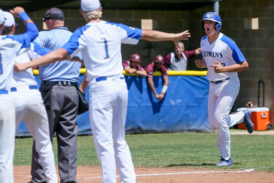 Clemens' Nick Hamel (right) is greeted by teammates at home plate after hitting a two-run homer in the third inning of Game 2 in a Class 6A bidistrict playoff series with Marshall on May 6, 2017. Photo: Marvin Pfeiffer /San Antonio Express-News / Express-News 2017