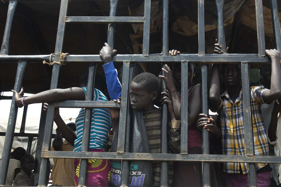 South Sudanese children arrive at a refugee settlement in northern Uganda last month. The United Nations reports that more than 1 million children have fled South Sudan's civil war. Photo: Jerome Delay, Associated Press