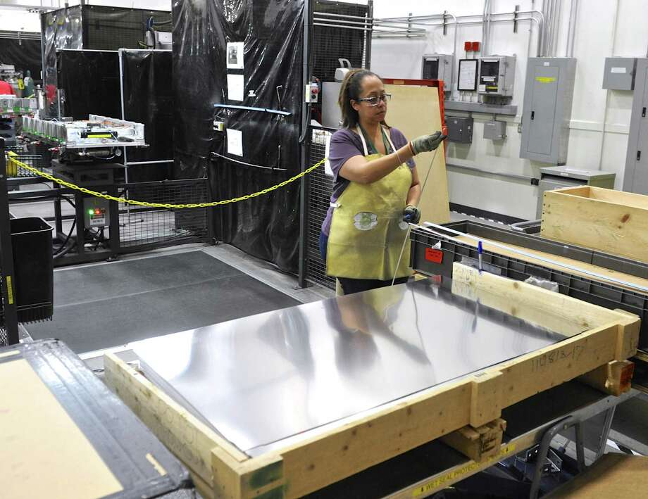 Raquel Johnson readies pieces for a component to be welded at FuelCell Energy manufacturing plant in Torrington, Conn. Wednesday, February 1, 2017. Photo: H John Voorhees III / Hearst Connecticut Media / The News-Times