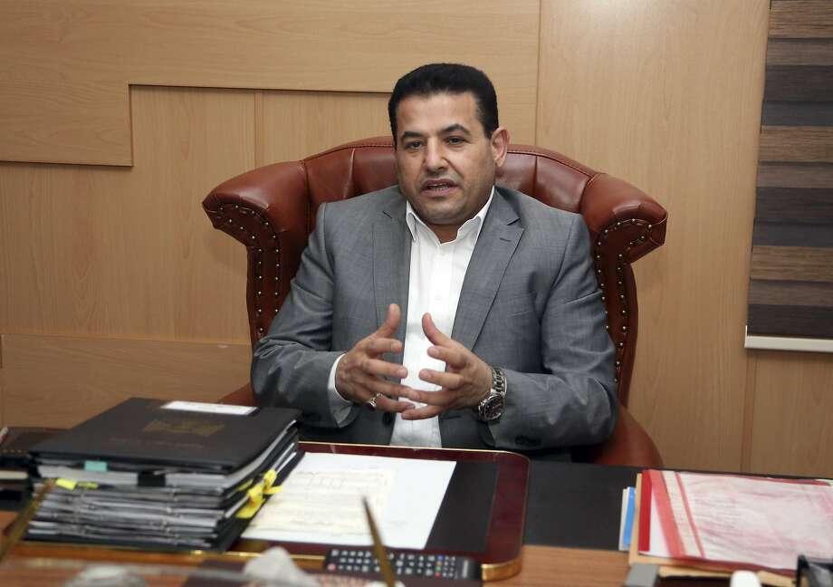 Interior Minister Qasim al-Araji once was accused of smuggling arms used against U.S. troops. Photo: Karim Kadim, Associated Press