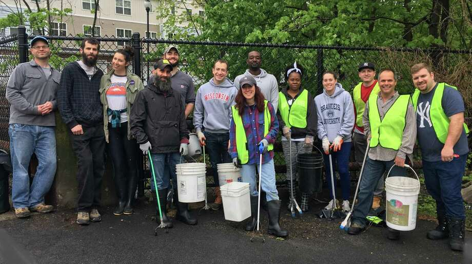 Volunteers from Get Downtown Danbury during Clean City Danbury Day. Photo: / Submitted Photo