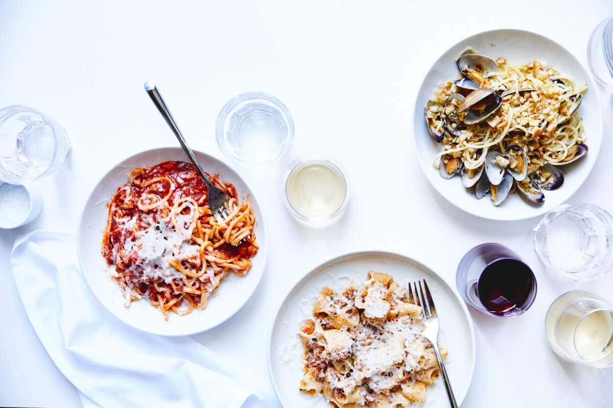 Top left: bucatini all' amatriciana, tomato, pancetta, pecorino $14; Top right: spaghettini, clams, chili, lemon, pangratatto $14; Bottom: rigatoni, pork sugo $14. Photo via A Mano