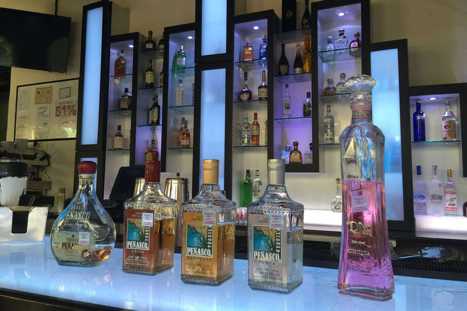 In this file photo, bottles of liquor are shown at a downtown Laredo bar. Photo: Bradley L. From Yelp
