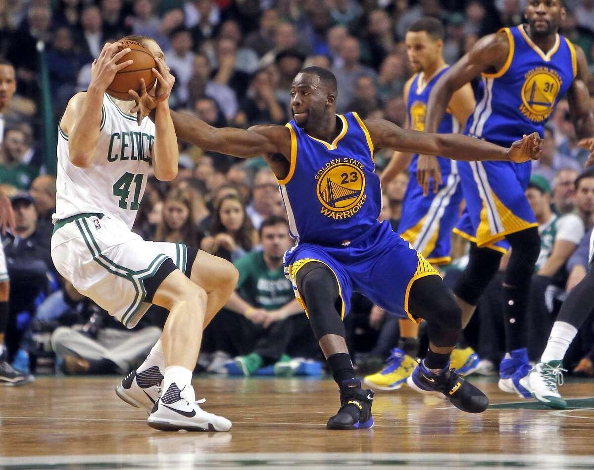 Golden State Warriors' Draymond Green and Boston Celtics' Kelly Olynyk during NBA game at TD Garden in Boston, Massachusetts on Friday, December 11, 2015.