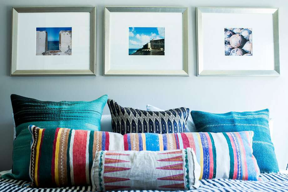 Colorful pillows and photographs add personality. Photo: Stephen Lam, Special To The Chronicle