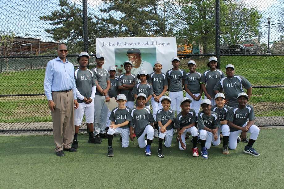 Stamford NAACP President Jack Bryant, far left, photographed with the Building Land and Technology sponsored Jackie Robinson Little League team during opening day on Tuesday, May 2. Photo: /