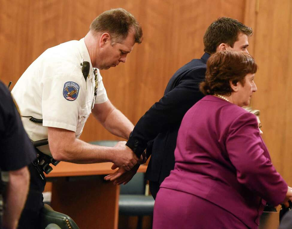 Alexander West is handcuffed following the reading of the verdict of the 12 counts against him Monday afternoon, May 8, 2017, in the fatal boat crash trial in Warren County Court in Queensbury. West was found guilty of eight of 12 counts with the weightiest charge being second-degree manslaughter. (Shawn LaChapellel/pool photo via Post-Star)