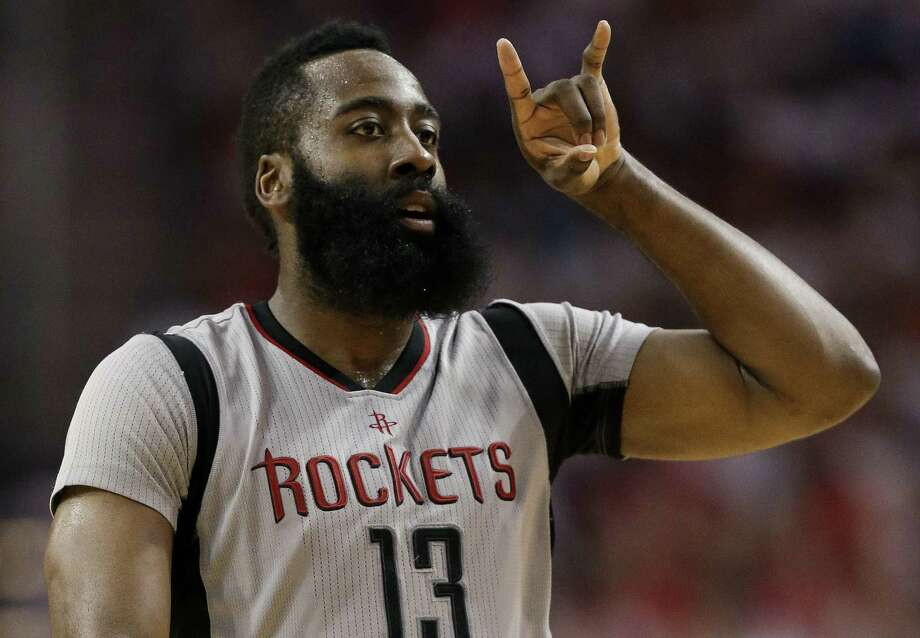 Rockets guard James Harden reacts after making a 3-point basket during the second half in Game 4 against the Spurs on May 7, 2017, in Houston. Photo: Eric Christian Smith /Associated Press / FR171023 AP