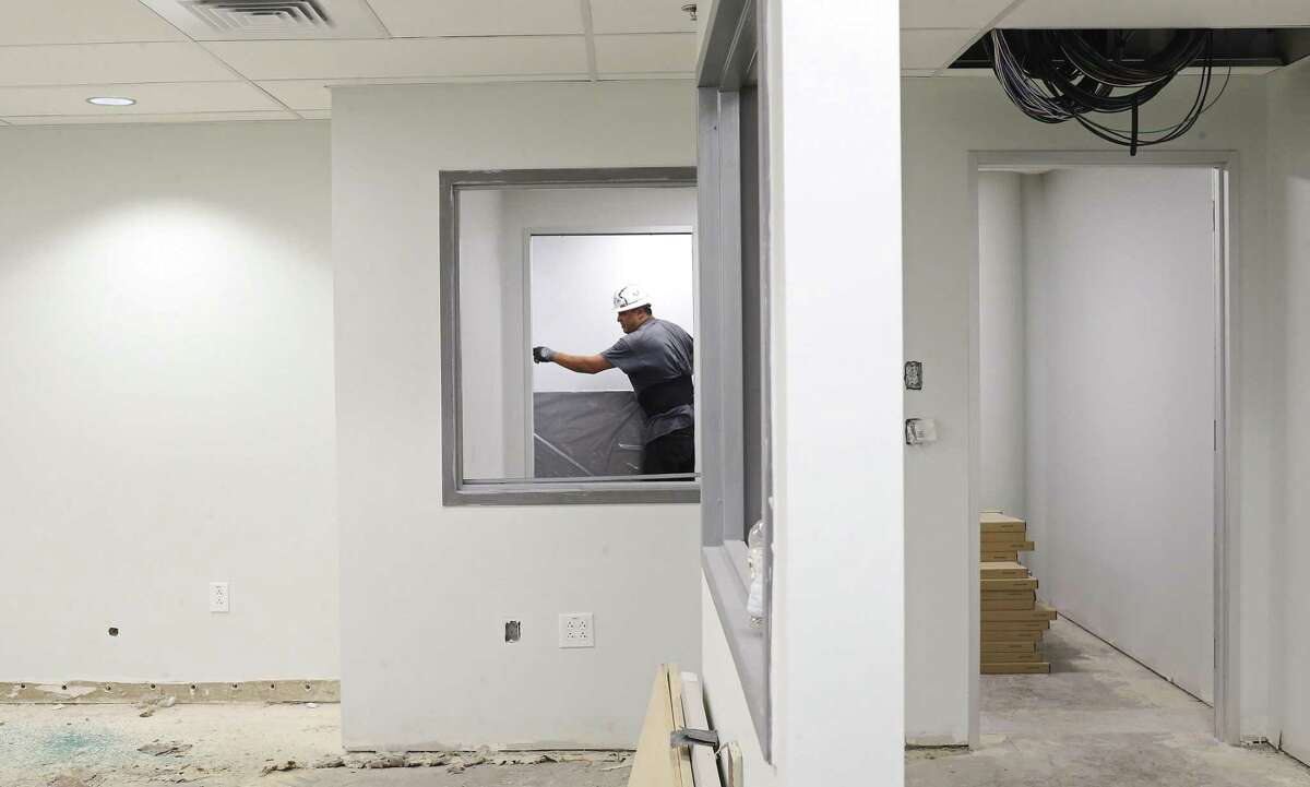 Gabriel Smith works sheetrock at the PVA offices located on the 600 block of north Main.