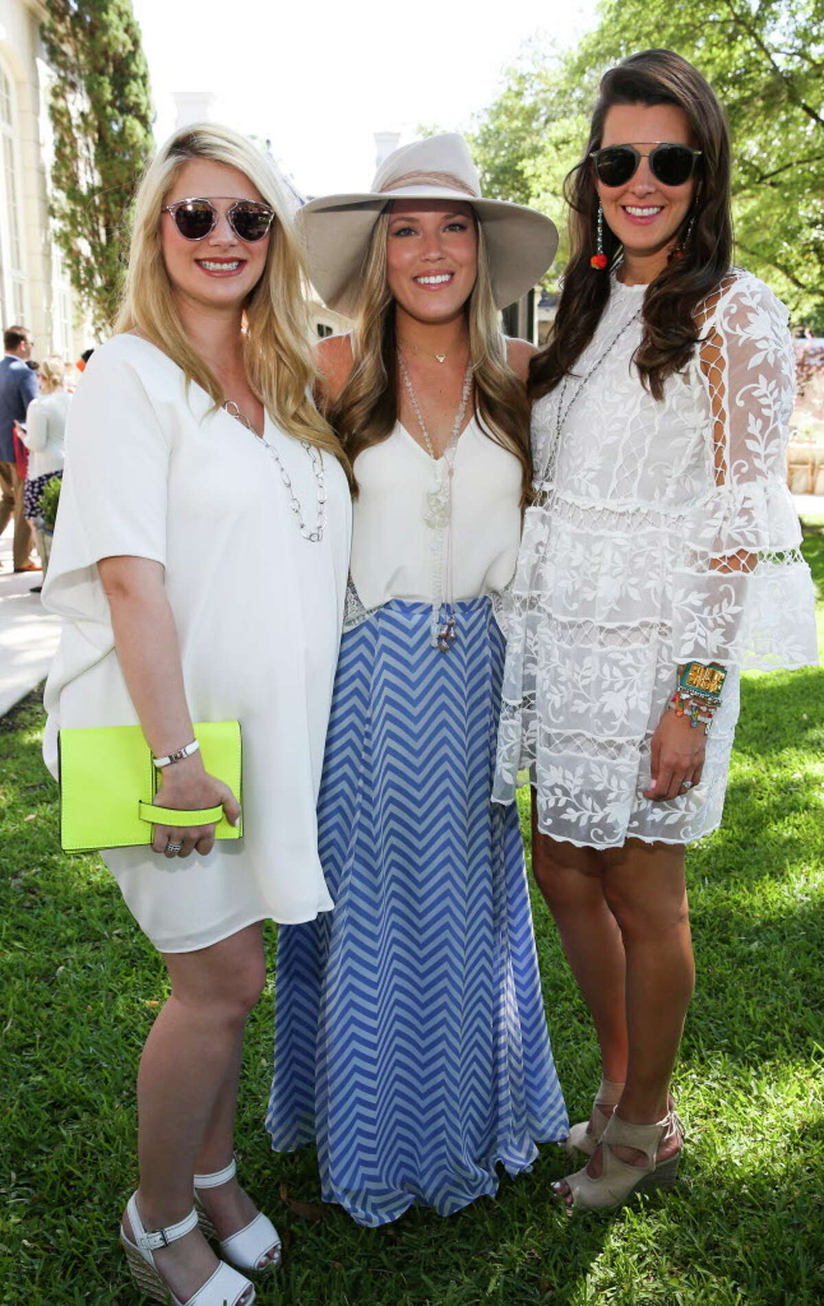 Christine Falgout, from left, Holly Alvis and Kathryn Swain pose for a photo at the inaugural Hats, Hearts, and Horseshoes Kentucky Derby Party