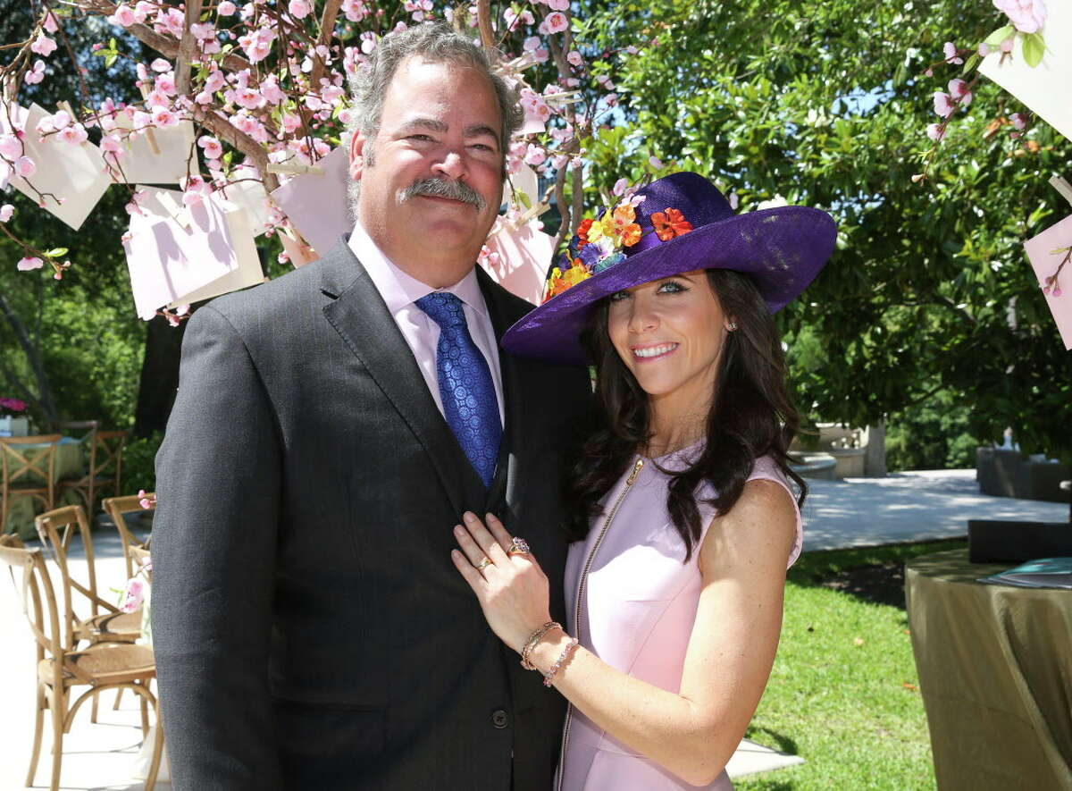 The inaugural Hats, Hearts, and Horseshoes Kentucky Derby Party Chairs Hannah and Cal McNair