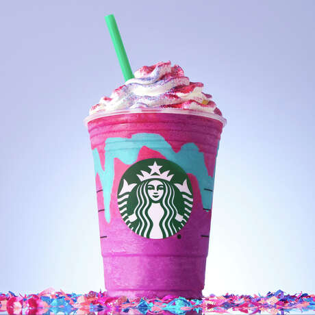 """Starbucks' """"""""Unicorn Frappuccino""""  starts as a purple drink with blue swirls that tastes sweet and fruity, before changing to pink with a tangy and tart taste with a stir of the straw — and this was just one of the food trends that people went crazy for in 2017. Photo: HONS / Starbucks"""