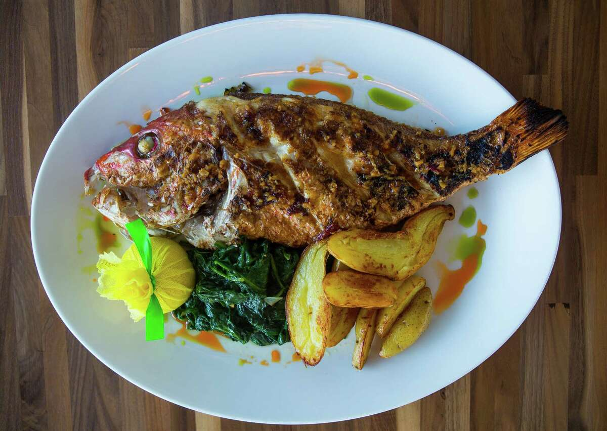 Michael Samboroks, owner-operator of The Pit Room barbecue joint, has acquired Star Fish, Pi Pizza and Lee's Fried Chicken & Donuts, all formerly under Cherry Pie Hospitality restaurant group. Shown: whole Gulf red snapper at Star Fish.