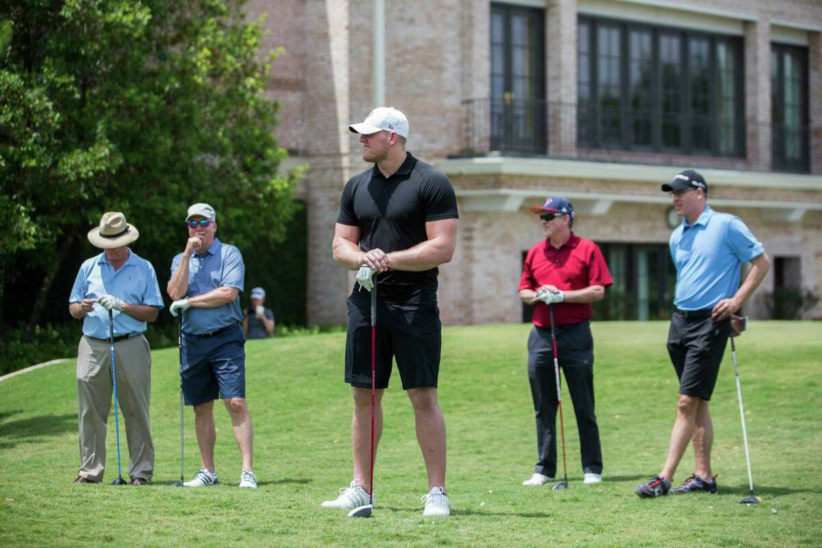 Texans J. J. Watt, center, waits for his opportunity to tee off surrounded by River Oaks Country Club guests, Monday, May 8, 2017, in Houston. The Texans golf tournament is meant to raise funds for charity.