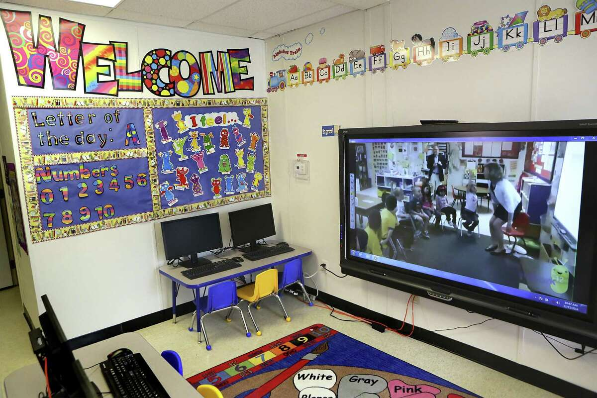 """A school room setting for children residents at the South Texas Family Residential Center. Secretary of Homeland Security Jeh Johnson toured the new South Texas Family Residential Center, just outside Dilley, Texas. Detained immigrants that are currently being held in Artesia will begin arriving at the Dilley facility within the next two weeks. Monday, Dec. 15, 2014. This pictured facility, which was a """"man camp"""" for the oil industry, will be used for approximatly 45 day until the new facility is completed in the adjoining lot."""