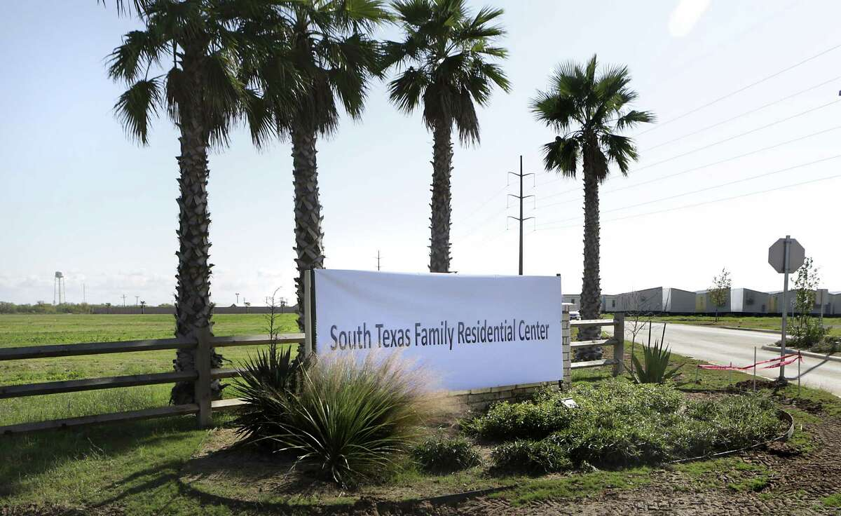 """Secretary of Homeland Security Jeh Johnson toured the new South Texas Family Residential Center, just outside Dilley, Texas. Detained immigrants that are currently being held in Artesia will begin arriving at the Dilley facility within the next two weeks. Monday, Dec. 15, 2014. This pictured facility, which was a """"man camp"""" for the oil industry, will be used for approximatly 45 day until the new facility is completed in the adjoining lot. The building units at the far right will be used on the new facility."""