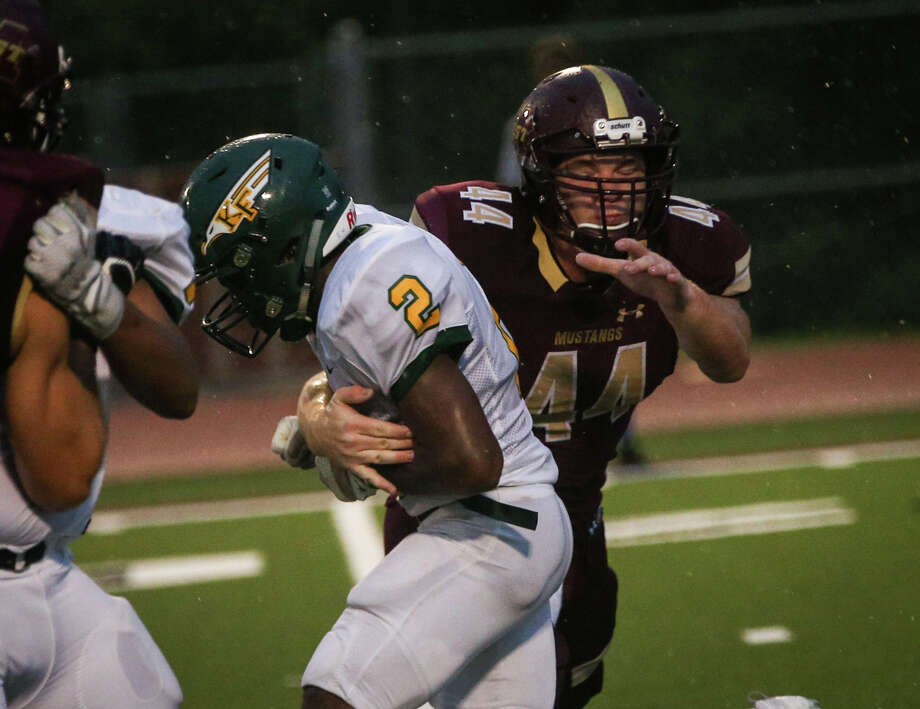 Magnolia West's Dustin Parmely (44) tackles Klein Forest's Trayvon Valentine (2) during first half of the varsity football game on Friday, Aug. 26, 2016, at Magnolia West High School. Photo: Michael Minasi, Staff / © 2016 Houston Chronicle