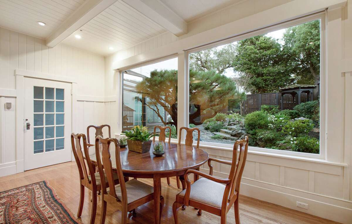 This classic Arts-and-Crafts home at 3157 Jackson St. has two bedrooms, two bathrooms and a beautiful garden designed by celebrated landscape architect Thomas Church.