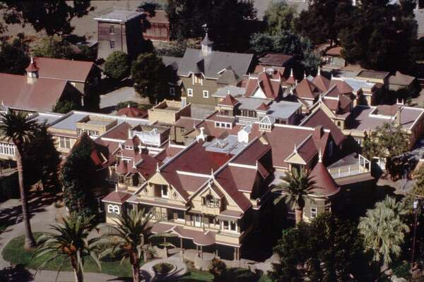 The Winchester Mystery House grew from an eight-room farmhouse to a maze of 160 rooms over 40 years after the separate deaths of Sarah Winchester's husband and infant daughter.