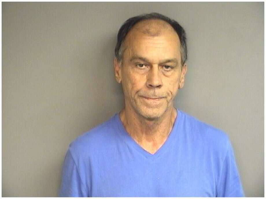 Jorge Restrepo-Vinasco, 60, was charged along with his son, Ivan Vinasco, 29, with dealing cocaine and being in possession of more than an ounce of the narcotic when police raided his East Side home on Friday. Photo: Stamford Police / Contributed