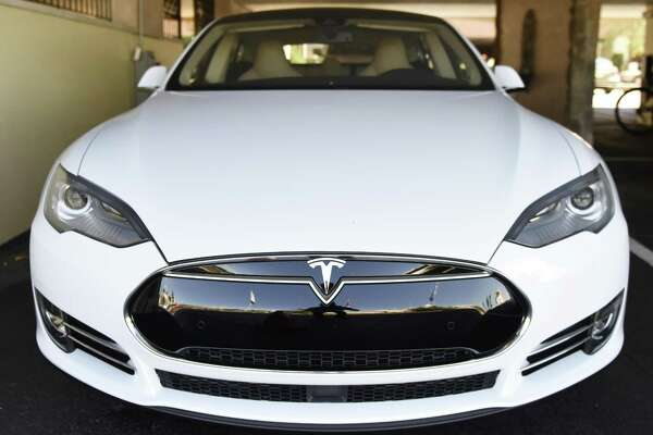 The Tesla Model S shuttle car is parked in the parking lot at the Delamar in Greenwich, Conn.