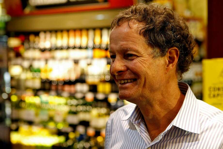 John Mackey talks to a fan during a signing of his book, Conscious Capitalism, at the Whole Foods in Potrero on January 22, 2013 in San Francisco, Calif. Mackey is both co-founder and co-CEO of the Whole Foods supermarket chain. Photo: Sean Havey, The Chronicle