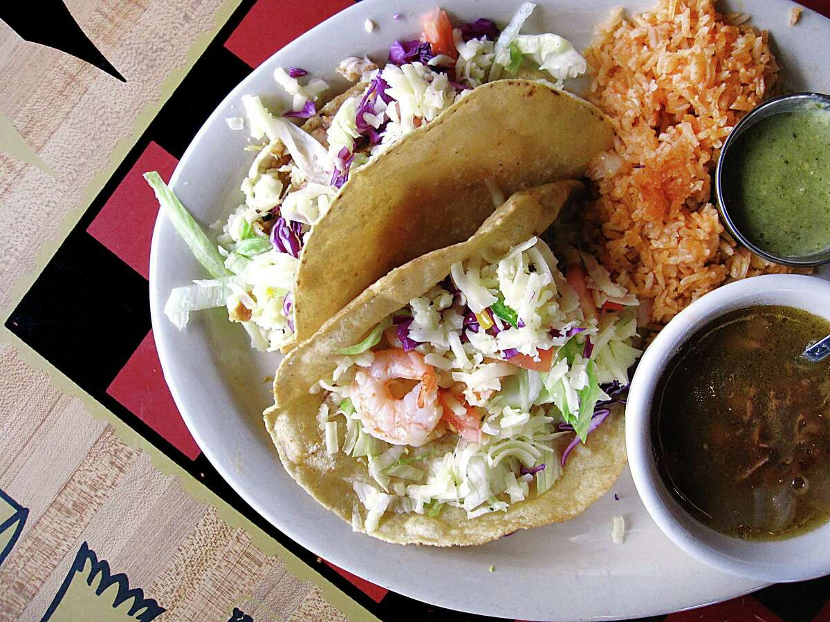 Fish and shrimp taco plate with rice, charro beans and tomatillo sauce from Lee's El Taco Garage.