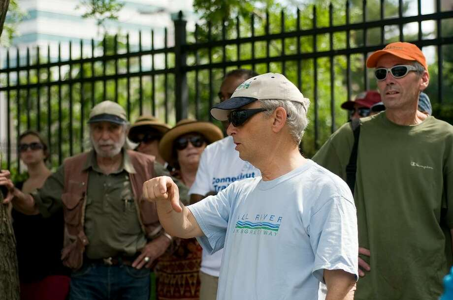 Trip leader Robin Stein (center) discusses the state of the Mill River during a downtown nature hike. About 35 people participated in the educational nature hike in downtown Stamford, as part of the 18th Annual Connecticut Trails Day Celebration on Saturday, June 5, 2010. The walk was sponsored by the City of Stamford and the Mill River Collaborative. Stein is the Land Use Bureau Chief for the city of Stamford. Photo: Shelley Cryan / Shelley Cryan