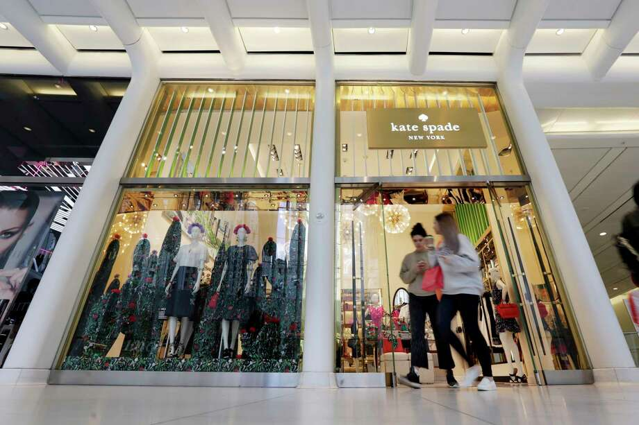 Coach will spend $2.4 billion for Kate Spade, tying together two premier brands in the luxury goods sector that have fought to snare younger shoppers. Photo: Richard Drew, STF / AP