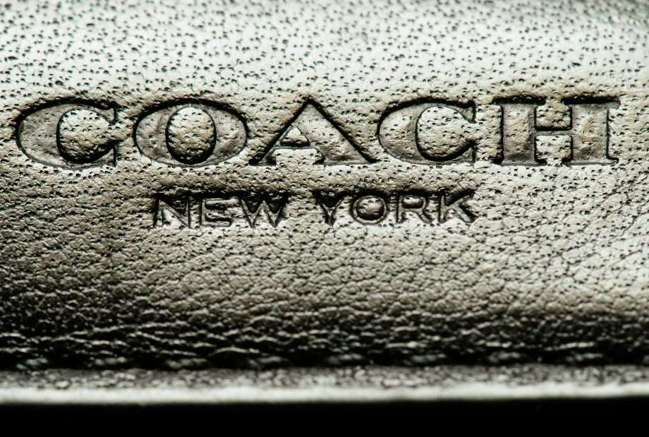 Coach Inc., the iconic New York-based leather goods maker, is changing its corporate name to Tapestry Inc. at the end of the month, a bid to broaden its image after acquiring the Kate Spade and Stuart Weitzman brands.See how Chron.com fashion experts say women's purse needs change with age... Photo: Matt Rourke, STF / Copyright 2017 The Associated Press. All rights reserved.
