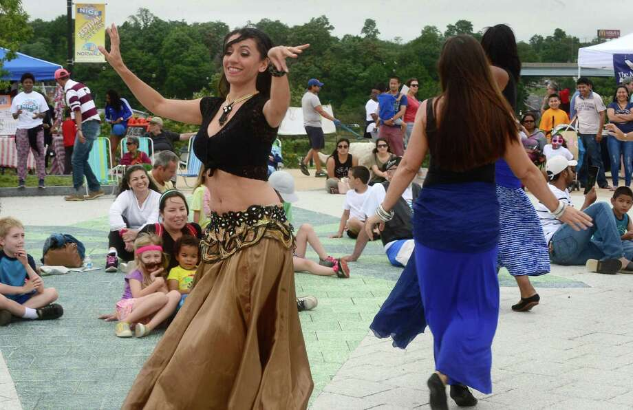 Tava Naiyin of Belleydance by Tava performs with her students during the inaugural Norwalk International Cultural Exchange (NICE) Festival on July 9, 2016, at Oyster Shell Park in Norwalk. The NICE Festival hosted dancers, musicians, vendors and local international restaurants and encouraged the community to spend the day together. Photo: Erik Trautmann / Hearst Connecticut Media
