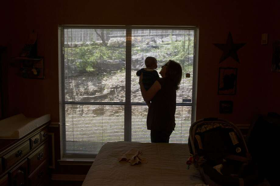 "Kathy Friend, a ""therapuetic foster parent,"" holds an infant she is babysitting for another foster care family at her home in San Antonio. Photo: Carolyn Van Houten /San Antonio Express-News / 2017 San Antonio Express-News"